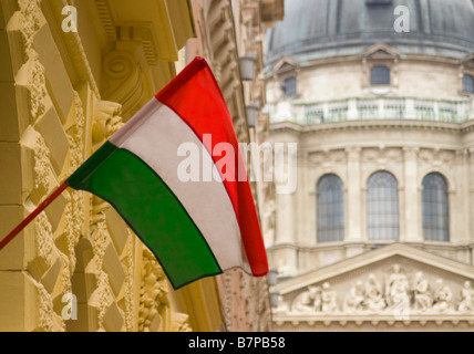 Budapest, Hungary. Hungarian flag flying in front of St Stephen's Cathedral - Stock Photo