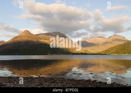 Loch Leven, Glencoe village and the Pap of Glencoe Sgorr na Ciche, Lochaber, Scotland, May - Stock Photo