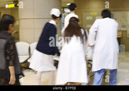 Doctors and nurses carrying urgent patient - Stock Photo
