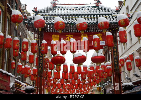 Chinese lanterns in the snow - Stock Photo