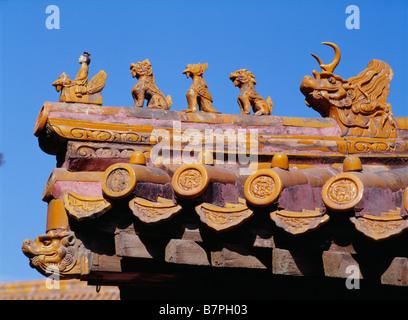 Forbidden City temple gargoyles roof sun Beijing China tiles detail - Stock Photo