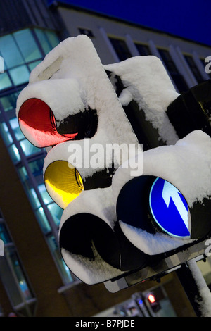 Snow covered traffic lights in early morning central Brighton - Stock Photo