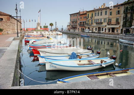 Early morning by the harbour in Lazise - Stock Photo