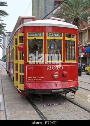 Red streetcar on Canal Street New Orleans - Stock Photo