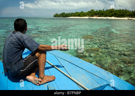 Negotiating the reef at Siladen Island, Sulawesi - Stock Photo