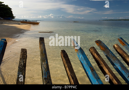 The ribs of a wrecked boat point the direction out to the reef at Siladen Resort and Spa, Sulawesi - Stock Photo