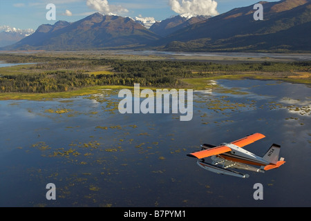 Turbo Beaver flightseeing over the Knik River Valley during Summer in Southcentral Alaska - Stock Photo