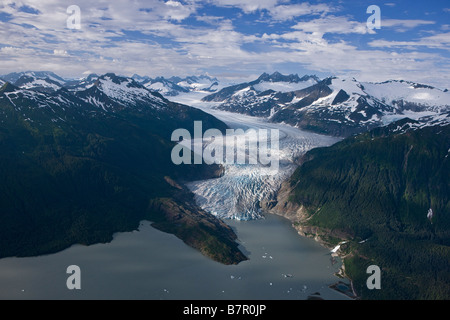 Aerial of Mendenhall Glacier winding its way down from the Juneau Icefield to Mendenhall Lake in Tongass National - Stock Photo