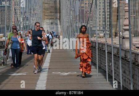 People on Brooklyn Bridge, New York City - Stock Photo