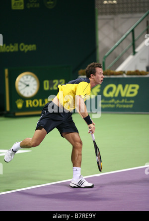 German tennis star Phillip Kholschreiber in action against Roger Federer at the Qatar Open January 2009 - Stock Photo