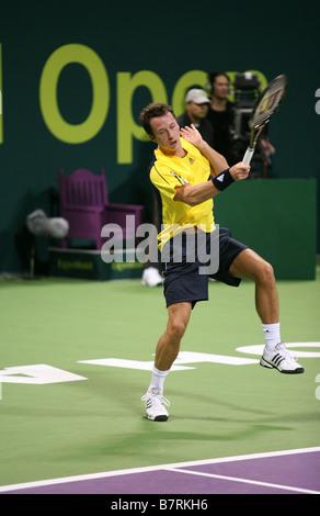 Philipp Kohlschreiber in action against Roger Federer Qatar Open 2009 - Stock Photo