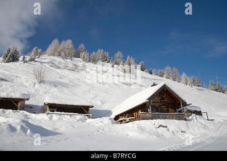 Pinzgau Region Austria EU January Alpine style chalets surrounded by deep snow in the Austrian Alps - Stock Photo