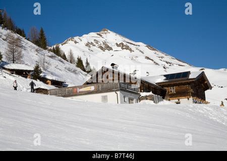 Pinzgau Region Austria EU January Looking across ski slopes to Bergrestaurant which provides services to skiers - Stock Photo