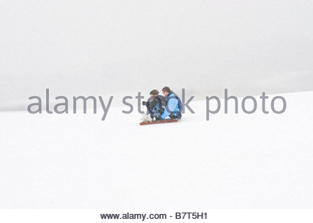 two boys on sledge going at speed - Stock Photo
