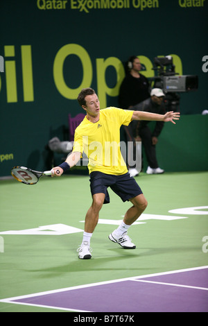 Philipp Kohlschreiber in action at the Qatar Open 2009 against Roger Federer - Stock Photo