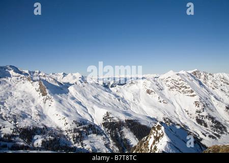 Pinzgau Region Austria EU January View along the snow covered Austrian Alps from a high viewpoint - Stock Photo