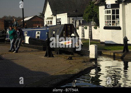 Narrow boat going through lock at Stourport, on the Staffordshire and Worcestershire Canal - Stock Photo