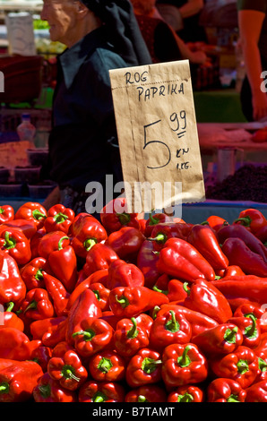 Zagreb, Croatia. Red Peppers on sale in Dolac fruit and vegetable market, with price written on paper bag - Stock Photo