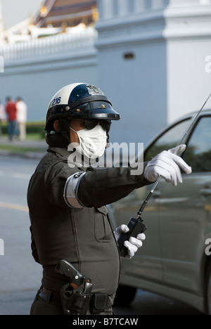 Police traffic control officer wearing mask against pollution Pathumwan district in central Bangkok Thailand - Stock Photo