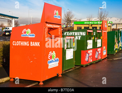 A Bank of recycling bins in a supermarket car park. - Stock Photo
