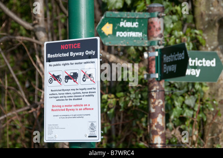 Restricted Byway sign - no rights for motor vehicles and footpath signs. - Stock Photo