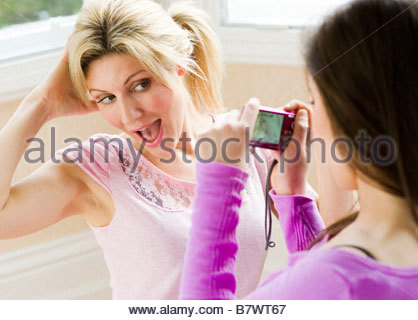 2 Girls having fun taking picture of each other - Stock Photo
