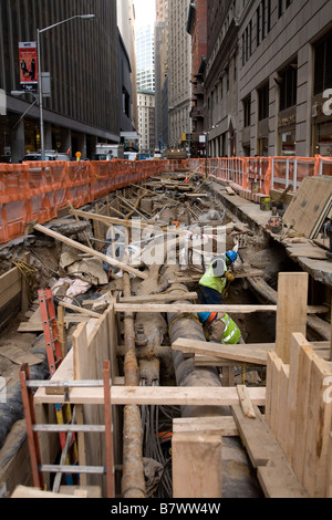 Working under Beaver Street on infrastructure in the financial district in New York City - Stock Photo