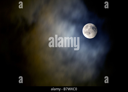 MOON SHOT  IN A CLOUDY NIGHT SKY - Stock Photo