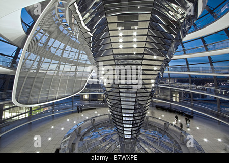 Reichstag building cupola by Sir Norman Forster at twilight group of people Berlin - Stock Photo