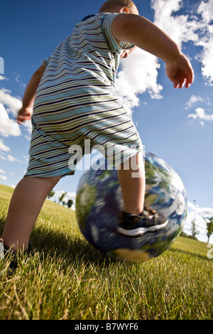 Child playing with ball - Stock Photo
