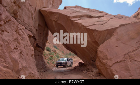 A 4WD vehicle on the Long Canyon Jeep Trail near Moab Utah - Stock Photo