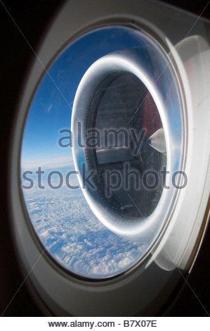 engine of an airplane in flight - Stock Photo