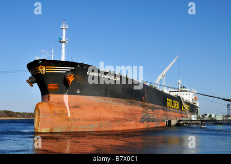 Fuel tanker Energy Chancellor tied off to pier from a low angle at the bow - Stock Photo