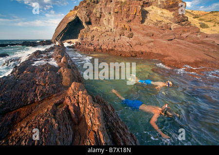 two boys snorkeling in the Shallows at Hallett Cove - Stock Photo