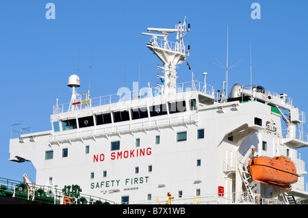 Ship's bridge or superstructure showing radar electronics lifeboat 'no smoking' and [safety first signs] on a oil - Stock Photo