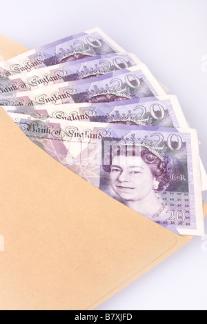 English twenty pound notes inside an envelope. - Stock Photo