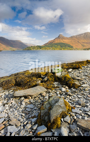 Looking across Loch Leven to Glencoe village and the Pap of Glencoe Highlands Scotland - Stock Photo