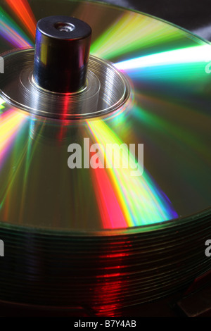 Stack of CD's on a spindle lit with coloured lighting - Stock Photo