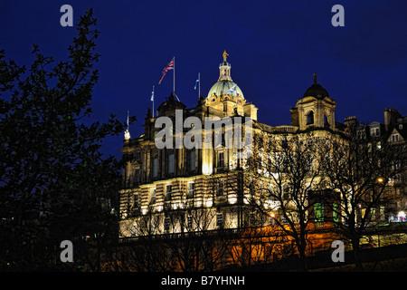 The former Bank of Scotland headquarters on Edinburgh's Mound Illuminated at night - Stock Photo