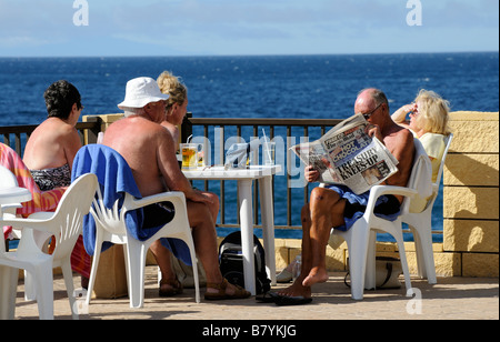Holidaymakers enjoying the warm sunny climate of Los Gigantes Tenerife Canary Islands - Stock Photo