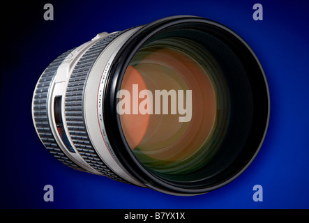 A white body lens with ruby red coatings on the front elements This one os an 80 200 zoom from an SLR digital camera - Stock Photo