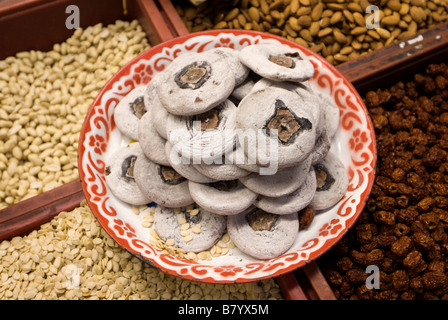 Dried figs and assorted fruit and nuts for sale Trok Issaranuphap market alleyway - Chinatown in central Bangkok - Stock Photo