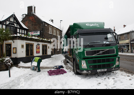 Carlsberg delivery lorry truck to a local pub in Downend Bristol in snow winter - Stock Photo
