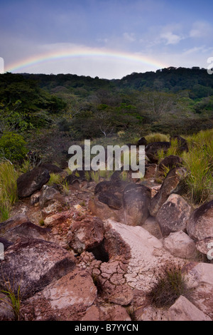 Vapor rises from a volcanic fumarole field with a rainbow at the Rincón de la Vieja Volcano National Park in Guanacaste, - Stock Photo
