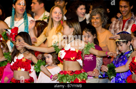 Young hula dancers with audience members - Stock Photo