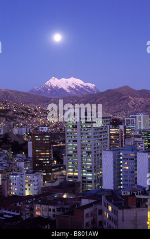 Full moon rise over Mt Illimani and central La Paz, Bolivia - Stock Photo