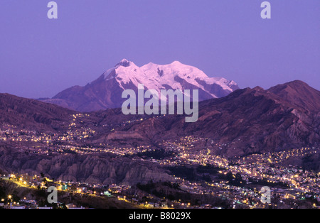 Lights of Zona Sur and Mt Illimani at sunset, La Paz, Bolivia - Stock Photo