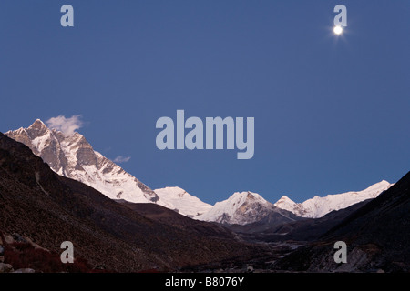 Scenic of Chukung Valley at nightime with majestic Lhotse peak seen on left side in Khumbu region Nepal - Stock Photo