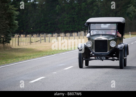 Vintage car on Highway 72, near Oxford, Canterbury, New Zealand - Stock Photo