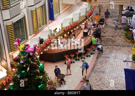 Christmas tree in Royal Promenade deck of Royal Caribbean Navigator of the Seas cruise ship - Stock Photo